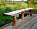 Rustic pine bench top and legs on deck